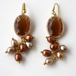 Earrings with an amber crystal, swarovski and champagne and bronze freshwater pearls.  18kt gold plated silver hook.